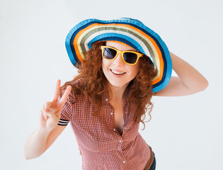 Funny summer girl showing victory sign