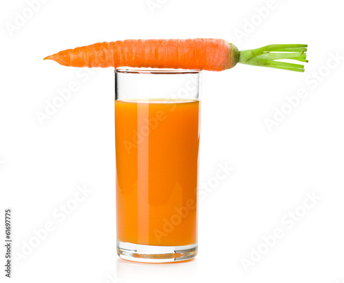 carrot juice in glass with carrot