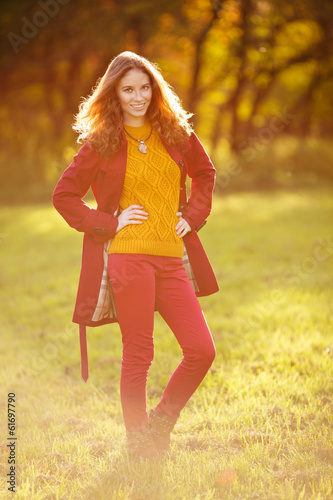 Outdoor portrait of beautiful redhead woman