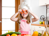 Funny chef girl cooking at kitchen