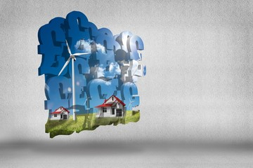Composite image of houses with wind turbines on abstract screen