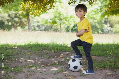 Cute little boy with football at park