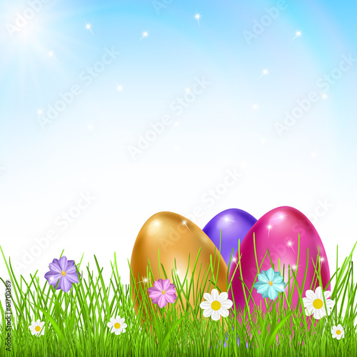 Three multicolored eggs in grass with flowers