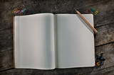 Editable blank vintage notebook on a wooden table.