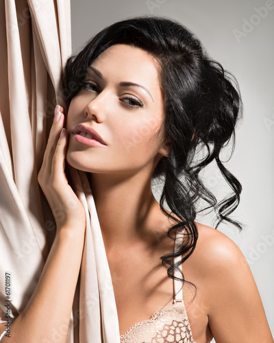 Portrait of a beautiful sexy tender woman with creative hairstyl