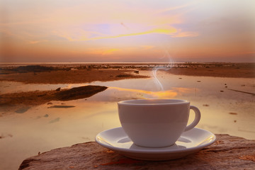 Coffee cup in the morning on terrace facing seascape