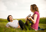 Playing guitar - romantic couple