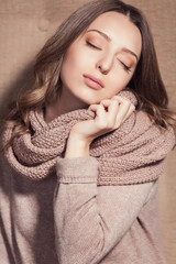 Portrait of happy girl in knitted sweater. Fashion photo