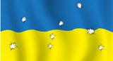 The Ukrainian flag with bullet holes