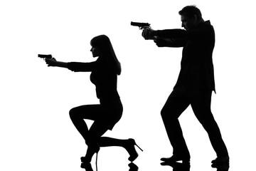 couple woman man detective secret agent criminal  silhouette