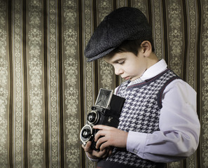 Child taking pictures with vintage camera