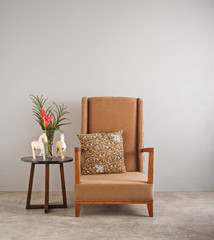 Beige upholstered chair with side table