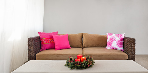 Beige sofa with advent flower arangement