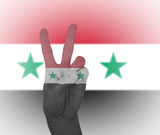 Hand peace sign with flag of Syria