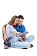 Couple using digital tablet