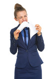 Angry business woman tearing documents