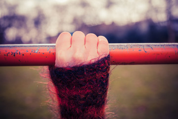 Hand on monkey bar