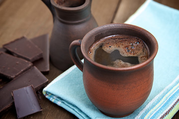 Coffee in a brown ceramic cup