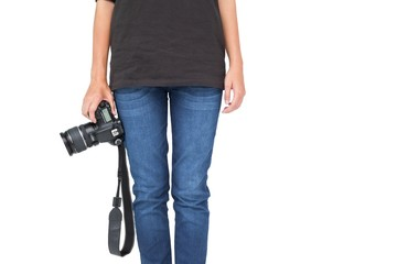 Mid section of a woman holding camera