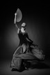 Black and white photo of young woman dancing flamenco