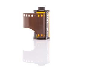 35mm still camera film cartridge over white background
