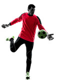caucasian soccer player goalkeeper man kicking ball silhouette