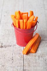 fresh sliced carrot in red bucket