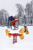 Colorful children playground equipment in snowy landscape