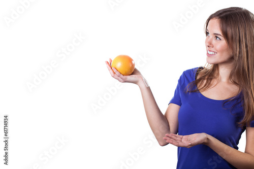 Smiling girl with orange