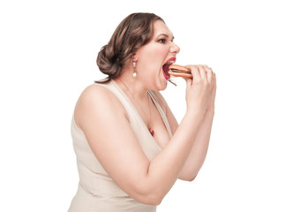Plus size woman eating hamburger
