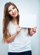 Teenager girl hold white blank paper. Young smiling woman show