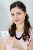 Young woman messaging on mobile phone