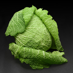 Savoy cabbage on a black background