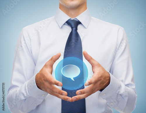 buisnessman holding something in his hands