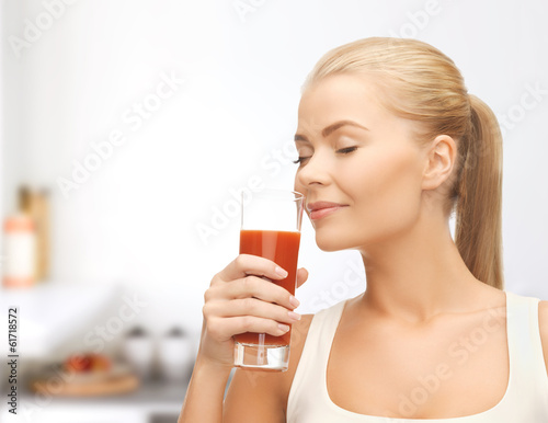 young woman drinking tomato juice