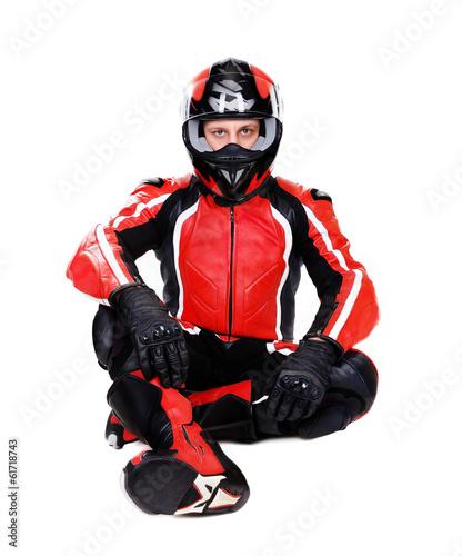 Deurstickers Fietsen motorcyclist in red sitting on the floor