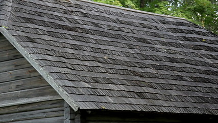 The old cedar wooden shingle shake roof of the log house