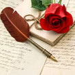 love letters, red rose and antique feather pen