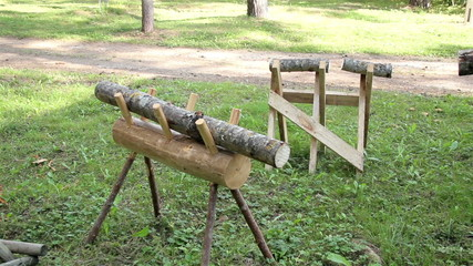 Two small logs on a wooden bench