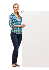 smiling young woman with white blank board