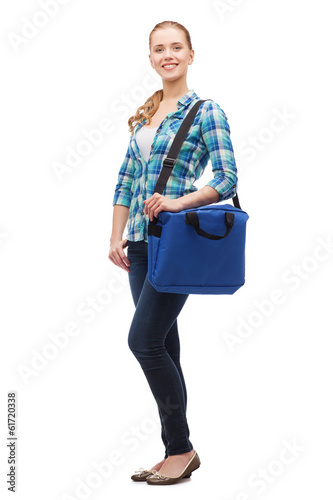 smiling female student with laptop bag