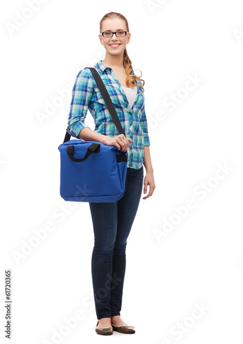 smiling female student in glasses with laptop bag