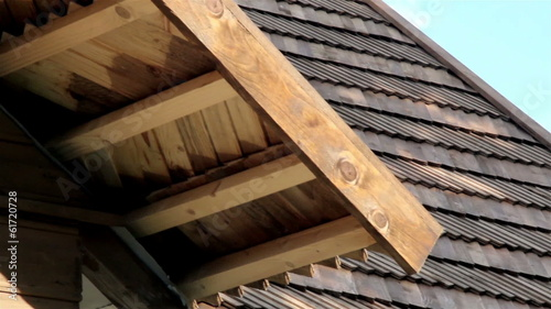 The oiled cedar wooden shingle roof of the house shake