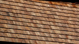 View of the side of the tar oiled cedar wooden shingle roof