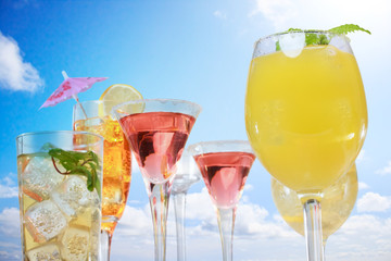 Assortment of drinks over blue sky