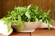 bowl with fresh green salad of arugula