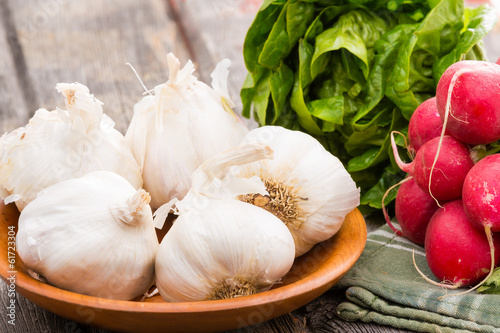 Fresh healthy garlic,. radish and lettuce