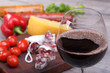 Red wine in the glass and food background