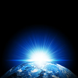 Earth planet in sun rays