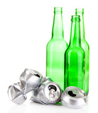 Crushed metal beer cans with glass bottles isolated on white